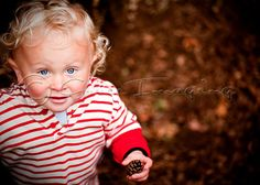 Having fun in the autumn leaves. Professional portrait photographer in Bath, Somerset, Wiltshire, South Gloucestershire and the South West