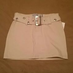 Khaki belted skirt. This belted khaki mini skirt can be dressed up for the club or dressed down for work. Skirts Mini