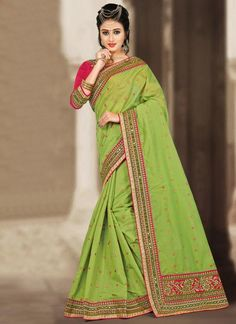 Experience the online shopping for indian traditional saree. Order this compelling mirror and resham work green traditional  saree.
