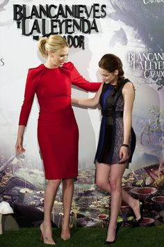 Charlize Theron and Kristen Stewart at a press conference for Snow White and the Huntsman in Madrid, May 17th