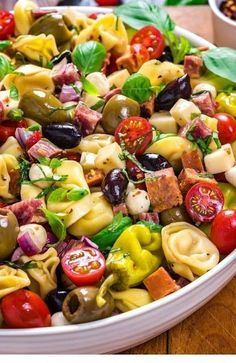 Antipasto Tortellini Pasta Salad - Host The Toast - Antipasto Tortellini Pasta Salad. This packed potluck favorite includes multiple cheeses, meats, olives, peppers, and more to create a hearty Italian-inspired summer side dish. Antipasto Salad, Antipasto Skewers, Fruit Salad, Antipasto Platter, Appetizer Salads, Antipasta Salad Recipe, Avocado Tomato Salad, Bacon Salad, Appetizer Recipes