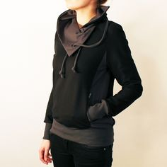 Black sweater with high collar, dark gray details