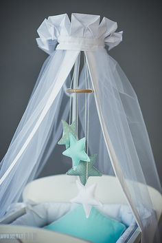 Nursery mobile Stars in mint and white. Baby mobile nursery decor made of wooden ring and stuffed tiny pillow stars. This sweet Star mobile will interest your baby and be a beautiful decoration of a crib. This item is only for the mobile, other items - canopy, decorative pillows, bedding you can find in my shop: https://www.etsy.com/shop/CotandCot For safety sake, keep the mobile out of your babys reach…