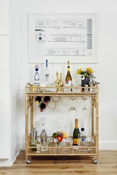Every home needs a fully stocked bar cart like this one at Damsel In Dior's…
