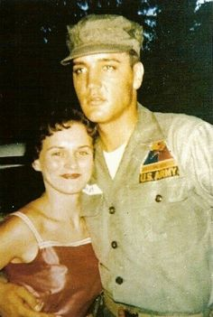 Elvis in the army; being photographed with a fan.