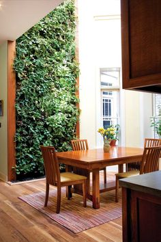 A three-story living wall—one of the largest in the U.S.—graces the dining room of this renovated early 1900s row house in the Fan District of Richmond, Virginia.