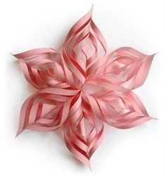 This Lacy Paper Snowflake may look super intricate, but don't worry; it's easy to make this lovely handmade ornament. Plus, it reminds us a bit of a beautiful spring flower.