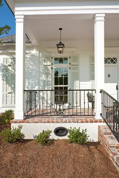 Brick porch floor with wood columns/New Orleans Charm with a Private Courtyard traditional porch Front Porch Railings, Brick Porch, Front Porch Design, Porch Columns, Front Porches, Porch Windows, Wood Columns, Porch Designs, Porch Steps