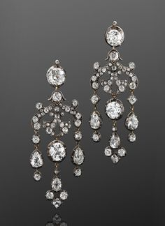 19th Century Old Mine Diamond Chandelier Earrings An intricate scrollwork suspends a total of approximately 19.60 carats of old mine diamonds set in silver top yellow gold.