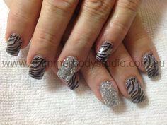 Gel nails, glitter nails, silver nails, crystals, stamping nail art .