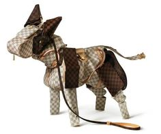 Animal sculptures from Louis Vuitton handbags and accessories by British artist Billie Achilleos to celebrate the 100th anniversary of the Louis Vuitton SLG Savoir Faire collection.