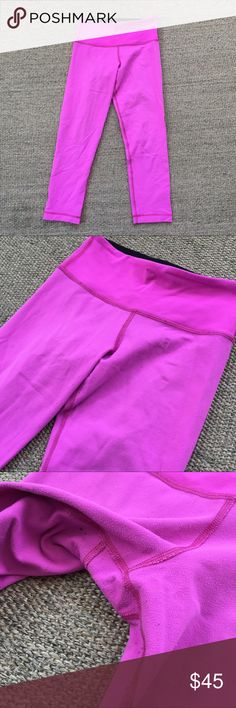 lululemon Pink Wunder Under Crop Leggings 2 Well worn condition. Lots of piling all over from normal wear. I've tried to hang dry my lulu stuff as much as possible. These are reversible; the inside black side doesn't have as much piling. I believe the color is Pink Paradise: it's an orchid color of pink with a hint of purple. I normally wear a 4 bottom in lulu but can fit into these, being a slightly tighter fit of course.  🐾 Pet-friendly, smoke-free home. 🚫 No trades. No holds. 📦 Fast…