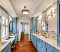 Isle of Palms! I can't imagine owning a home there, especially one this amazing! Herlong and Associates Architecture + Interiors designed this beauty, taking care of all of the details from start to finish. And details there are...every little inch of this home is gorgeous! The ceilings, walls, cabinetry, flooring, furnishings! The rustic touches, blue-filled color palette and of course the breathtaking view are perfection too!