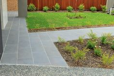 Bluestone paving front path, next to exposed aggregate concrete driveway. www.intrinsiclandscapes.com.au