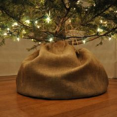Put the tree on a circle of burlap and cinch the top shut with twine. Cute idea and probably super cheap! Right up my alley!!