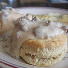 Sausage Gravy (allrecipes)      1 pound sausage      1/4 cup all-purpose flour      2 cups milk      Salt and black pepper to taste      8 prepared biscuits