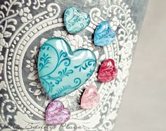 card embellishment ... glossy accents over hearts punched from printed papers ....