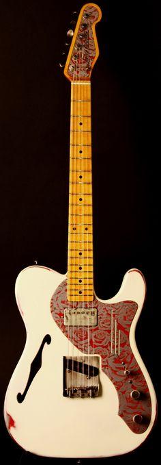 Fancy. James Trussart® Deluxe Steelcaster, Cream over Red | Ludlow Guitars