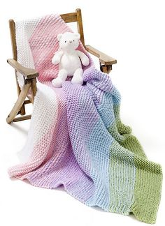 Darlene Dale gives us a wonderful baby blanket knit entirely in garter stitch in Simply Soft®. By simply dropping and picking up colors, this gorgeous Gradient Garter Baby Blanket offers a soft sophisticated look using everyone's favorite stitch. Darlene shows you how to accomplish this subtle striped effect to create the star gift at the next baby shower.