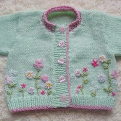 Mint Blush Beautiful baby cardigan with embroidered flower detail, hand knit using soft mint baby yarn and a warm pink contrast. Baby Knitting Patterns, Knitting For Kids, Baby Patterns, Knitting Projects, Hand Knitting, Sweater Patterns, Cardigan Bebe, Knitted Baby Cardigan, Baby Pullover