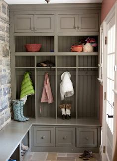 colorful mudroom - entry in a restored house with a stone wall and woodwork done in Sherwin Williams Zeus, a taupe - Greenable via Atticmag