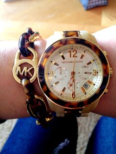Michael Kors watch and bracelet.