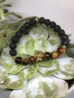 Tiger   Etsy Tiger Head, Stone Beads, Etsy, Beaded Bracelets, Golden Tiger, Semi Precious Beads, Handmade, Pearl Bracelets, Pony Bead Bracelets