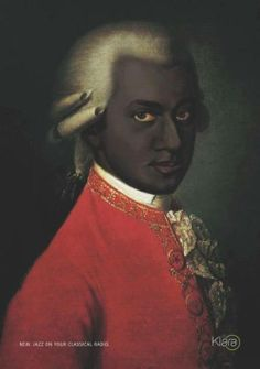 """Mozart was a Moor! This is what Mozart actually looks like. The image was found in a radio station in Belgium. The Moors (so-called 'Black' people) brought Classical Music to Europe. Not only that but when you read the REAL bios of him, he's described as having brown skin, """"negroid features"""" (broad, wide nose, etc) and wiry hair."""