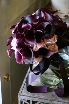 calla and rose bouquet.  Stunning