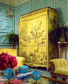 Bright yellow wardrobe with traditional Chinese landscape paintings on. Beautiful.