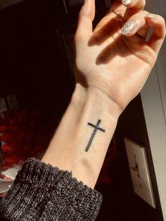 Simple cross tattoo on wrist Cross On Wrist, Cross Tattoo On Wrist, Small Cross Tattoos, Simple Cross Tattoo, Faith Tattoo On Wrist, Cross Tattoos For Women, Best Tattoos For Women, Wrist Tattoos, Mini Tattoos