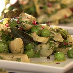 Braised artichokes with freekeh grains and herbs