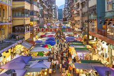 Get a slice of the real Hong Kong at Mongkok Ladies Market. Find out what to expect and learn how to find a bargain. Ladies Market, Kowloon Walled City, Lamma Island, Floating Restaurant, Wetland Park, Photography Career, Ocean Park, Tourist Spots, Viajes