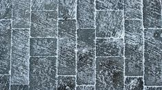 Winter Texture IV: A week of abstract textures inspired by the frigid beauty of Canadian winter. Up next, a light dusting of snow settles into pits and grooves,  highlighting the sweeping texture of a wintery flagstone walkway.