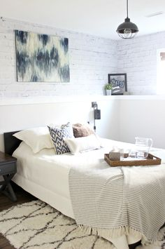 Beautiful Cheap Canvas Art is perfect in this basement bedroom! My teen would love this DIY. Great for their dorm room too!