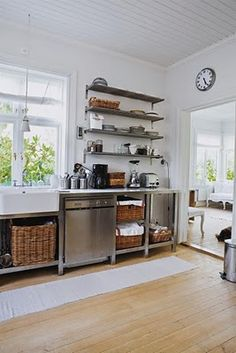 very close to what i'm picturing - metal shelves and recycled restaurant work tables with baskets for under counter storage