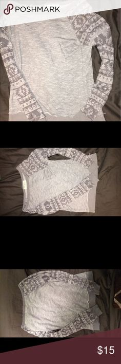 Sweater Cute. see through Aztec pattern arms. Sweaters