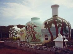 A Korean hotel in the shape of a giant pottery collection.  One of the beach houses is painted like the Arizona Iced Tea bottle.