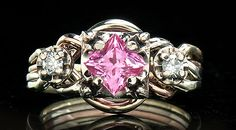 Crystal Realm: Hand-woven, Guinevere Royale four band puzzle ring with one-half carat princess-cut pink sapphire and two 5pt accent round diamonds on four colors of 14K gold: white, yellow, rose, and green