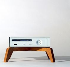 Your amps need cherry platform and aluminum framed and spiked stands, and your butt needs an Eames dowel chair. Give your console a midcentury modern throne of its own with Four Eyes Furniture's custom stands.