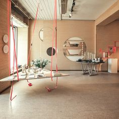 Pop-up store in Munich Chipboard backdrop, neutrals with pops of neon