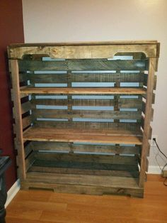 DIY Pallet Shelf. This would be great to keep on the porch for muddy shoes or to use for potting.