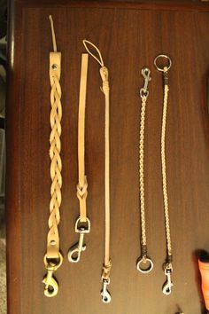 Here's a couple of tests for leather lanyards. The thinnest ones are braided leather cords, in a three-part and a four-part braid. Next to those are the single strap lanyards, and the big one on the end is a single strap 'Mystery Braid' with a big. Leather Lanyard, Leather Belts, Leather Cord, Leather Craft, Handmade Leather, Motorbike Accessories, Bag Accessories, Bracelet Making, Jewelry Making