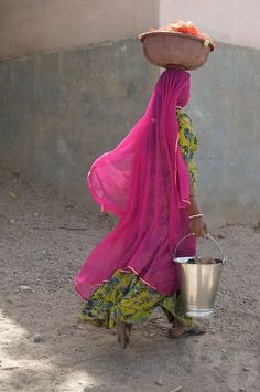 Beautiful Woman Carrying Food And Water.