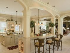 Love these arches and columns, open concept kitchen and great room.
