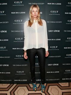 Leather pants and Ivory Blouse.  Love this trend.