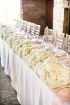 head table for bridal party with floral arrangement #weddingreception #headtable #weddingchicks http://www.weddingchicks.com/2014/02/07/pink-and-black-wedding/