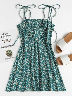 Floral Tie Strap Apron Mini Sundress. Cool off in our mini sun dress in allover flattering wildflower print. It features an apron collarline, self-tie shoulder straps, a fitted bodice, a gently smocked back, and a swishy skirt. Pair it with tanned sandals or heels. #Zaful #Zaful4th #Dress