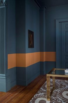 Explore stunning interior paint and wallpaper design inspirations from Paint & Paper Library. Like this feature wall of dark blue paint with an orange stripe. Colour Blocking Interior, Color Blocking, Modern Wall Paint, Paint And Paper Library, Wallpaper Wall, Mad About The House, Block Painting, Paint Color Schemes, Paint Colors