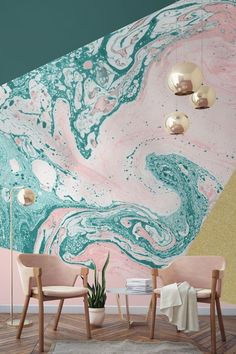 In love with this blush pink, marble and gold combination. Forest green melts into a pastel pink, giving a stark yet intriguing contrast of colours. The glittering gold in this design wallpaper mural helps to tie this living room together perfectly.